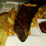 ClockTower - BBQ-Baby Back Ribs (EUR 12,50 - Steakfries, Knoblauchbrot, ... - Clocktower American Bar & Grill - Wien-Süd - Brunn am Gebirge